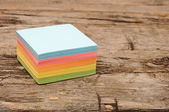 Sticker note paper on wooden background — Stock Photo