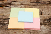 Stack of colorful sticky notes on wooden background — Stock Photo