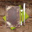 Blank paper with knife and fork on old wood background - Foto Stock