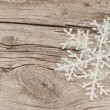 Christmas decorations (snowflake) on wooden background - Stockfoto