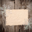 Stock Photo: Christmas background. blank old paper sheet with snowflakes
