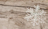 Christmas decorations (snowflake) on wooden background — Foto de Stock