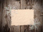 Christmas background. blank old paper sheet with snowflakes — Stock Photo