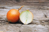 Organic onions on wooden background — Stock Photo