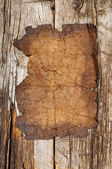 Old paper sheet over wooden background — Stock Photo