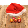 Stock Photo: Christmas ball with santclaus hat