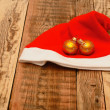 Christmas ball with santa claus hat — Stock Photo