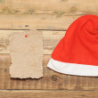 Christmas cap on grunge blank sheet of paper  — Stock Photo