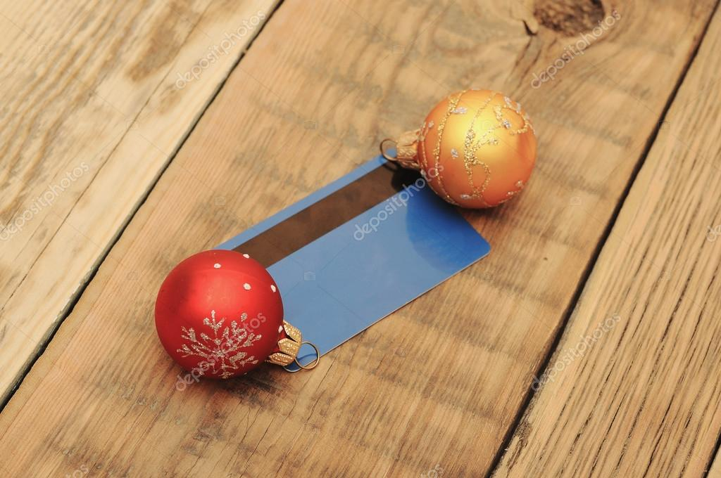 Christmas ball with greeting card  on wooden background  Stock Photo #14328391