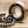 Steel ball bearings on wooden table — Stock fotografie