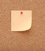 Cork board and blank note — Stock Photo