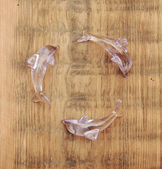 Recycling symbol made crystal transparent dolphins sculpture wit — Stock Photo