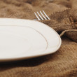 Close up knife and fork in old textile napkin — Stockfoto