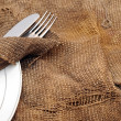 Close up fork and knife on textile napkin — 图库照片
