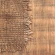 Burlap jute canvas vintage background on wooden boards — Stock Photo #14430811