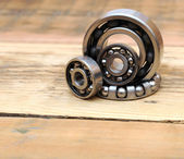 Steel ball bearings on wooden background — 图库照片