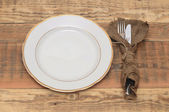 Empty plate with fork and knife on wooden table. — Stock Photo