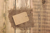 Price tag on wood background — Stock Photo