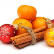 Tangerine, cinnamon and chrismas balls isolated on white backgro — Stock Photo