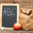 School lunch with  black chalkboard ready for your text. — Stock Photo