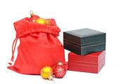 Christmas Decoration--Closeup of red christmas ball and gift on — Stock Photo