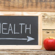 """health"" word on blackboard with arrow show on red apple — Stock Photo #14740019"