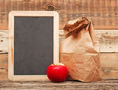 School lunch over blank blackboard — Stock Photo
