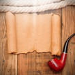 Old paper texture with a rope and a pipe — Stock Photo #14875855