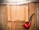Old paper texture with a rope and a pipe — Stock Photo