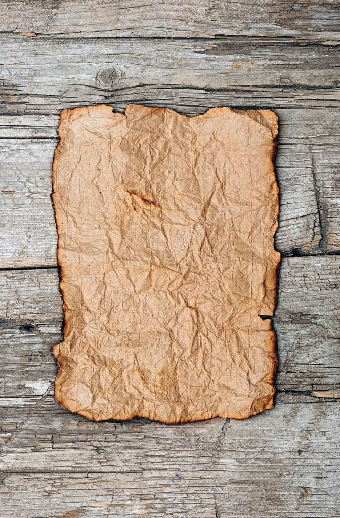 Old paper on wood panel  Stock Photo #14876105