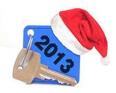 New Year 2013 date, red Santa cap on blue label with metal key — Zdjęcie stockowe