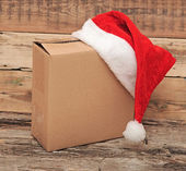Christmas present with santa hat close up — Stock Photo