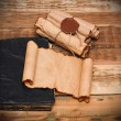 Scrolls of vintage paper with old book — Stock fotografie