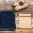 Scrolls of vintage paper with old book — Lizenzfreies Foto
