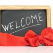 "Word ""welcome"" - white chalk handwriting on small school wooden — Stock Photo #15631557"