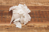 Stack of crumpled papers on wooden table — Stock Photo