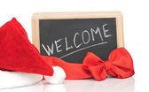 "Word ""welcome"" and santa hat on small blackboard — Stock Photo"
