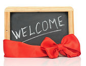 "Word ""welcome"" - white chalk handwriting on small school wooden — Stock Photo"