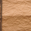 Old paper and silver chain with copy space - Stockfoto