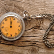 Vintage pocket watch on wood board — Photo