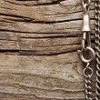 Close up metal chain on wood background — Stockfoto