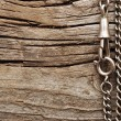 Royalty-Free Stock Photo: Close up metal chain on wood background