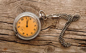 Vintage pocket watch on wood board — Stock Photo