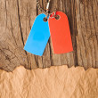 Blank tags blue and red with silver chain on vintage background — Stock Photo