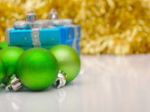 Gift boxes and christmas balls isolated on white. — Stock Photo