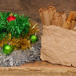 Christmas decoration with blank vintage paper on wooden table — ストック写真