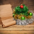 Christmas tree made of tinsel with old paper scroll — Stockfoto