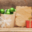 Christmas decoration with blank vintage paper on wooden table — Stock Photo
