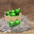 Christmas decoration on wooden plank — Stock Photo #16261619