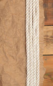винтаж бумаги и веревку на старые деревянные доски — Стоковое фото